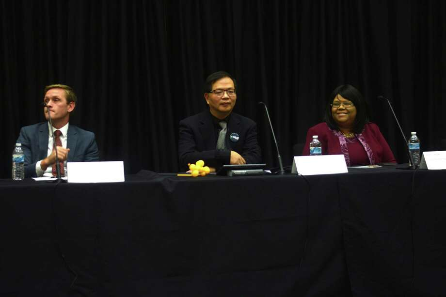 (Left to Right) Rob Ellis, James Wang and Mary J. Crosby sit next to each other awaiting to answer questions during the Klein ISD candidate forum on Oct. 3. Photo: Chevall Pryce