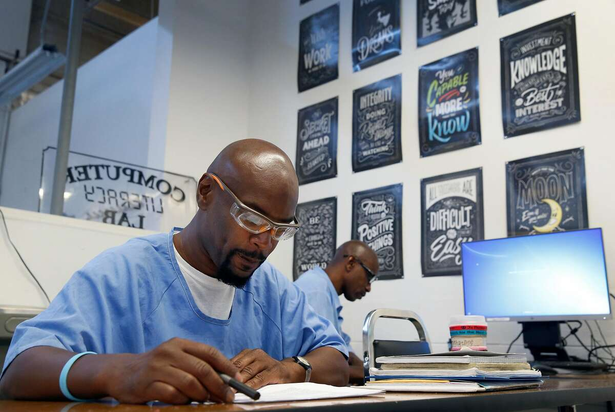 Derry Brown (left) and Richard Richardson attend a computer literacy class in the Robert E. Burton Adult School at San Quentin State Prison in San Quentin, Calif. on Thursday, Sept. 12, 2019. Burton has been designated as a