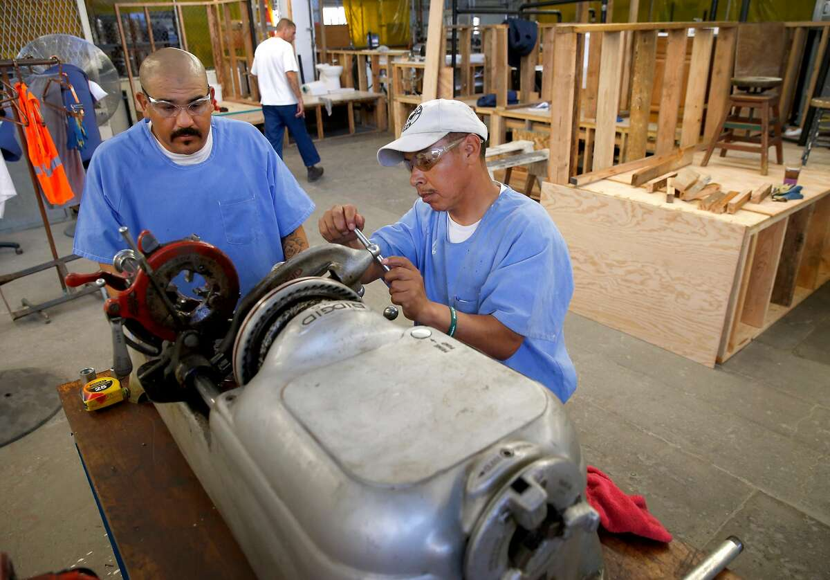 Ismail Rosas (left) and Sergio Carrillo thread galvanized pipe in a vocational plumbing class of the Robert E. Burton Adult School at San Quentin State Prison in San Quentin, Calif. on Thursday, Sept. 12, 2019. Burton has been designated as a