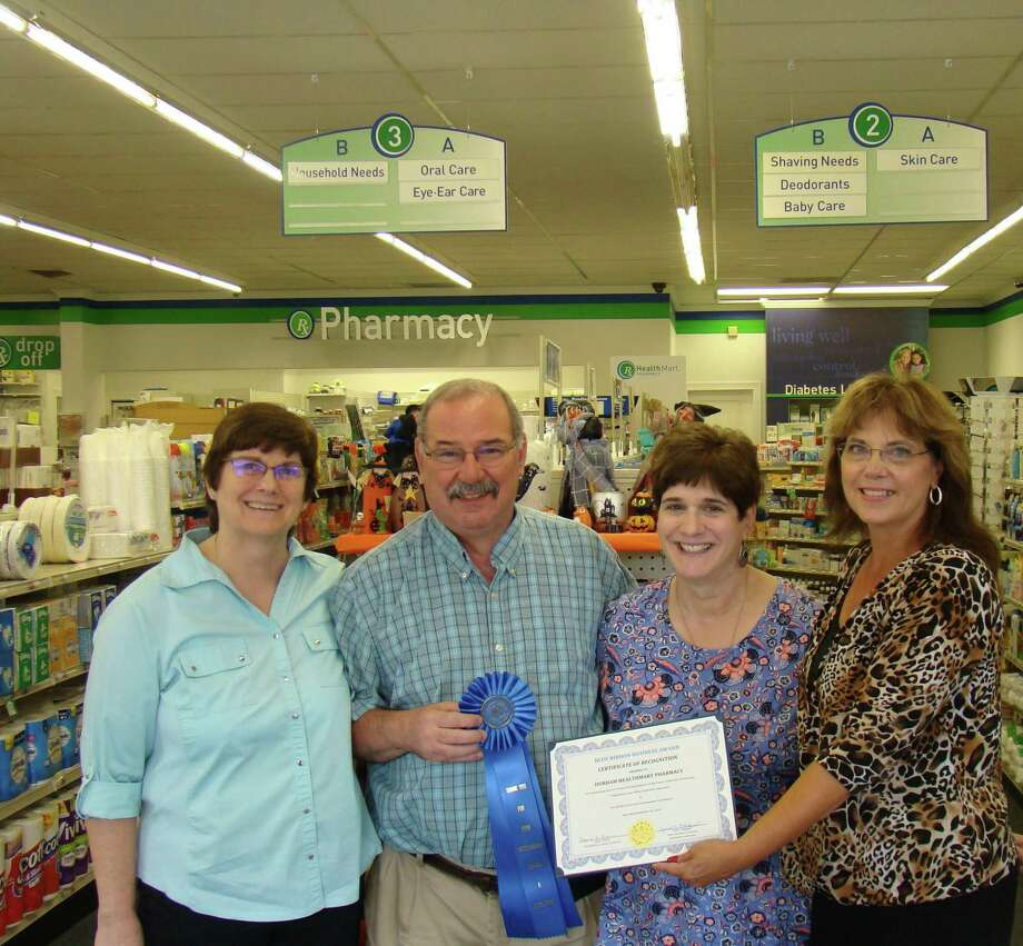 From left, Carol and Walter Douglass, owners of the Durham Healthmart Pharmacy, Janet Morganti, Durham Economic Development Commission, Laura Francis, Durham First Selectman. Photo: Christopher Morganti / Contributed Photo