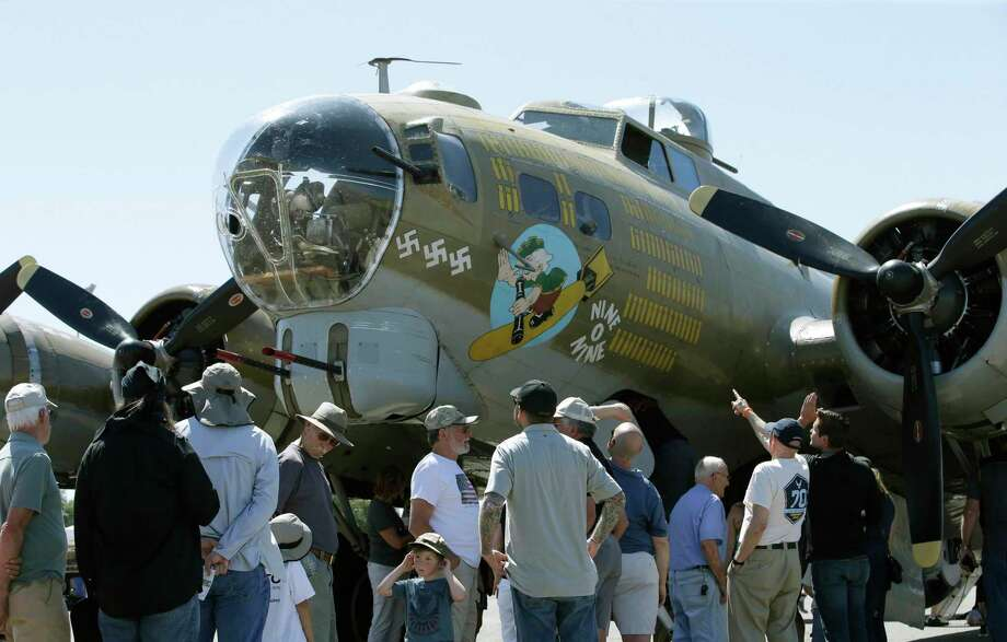 "In this photo taken June 2, 2018 photo, people look over the Nine-O-Nine, a Collings Foundation B-17 Flying Fortress, at McClellan Airport in Sacramento, Calif. A B-17 vintage World War II-era bomber plane crashed Wednesday, Oct. 2, 2019, just outside New England's second-busiest airport, and a fire-and-rescue operation was underway, official said. Airport officials said the plane was associated with the Collings Foundation, an educational group that brought its ""Wings of Freedom"" vintage aircraft display to Bradley International Airport this week in Windsor Locks, Conn. (AP Photo/Rich Pedroncelli) Photo: Rich Pedroncelli / Associated Press / Copyright 2019 The Associated Press. All rights reserved."