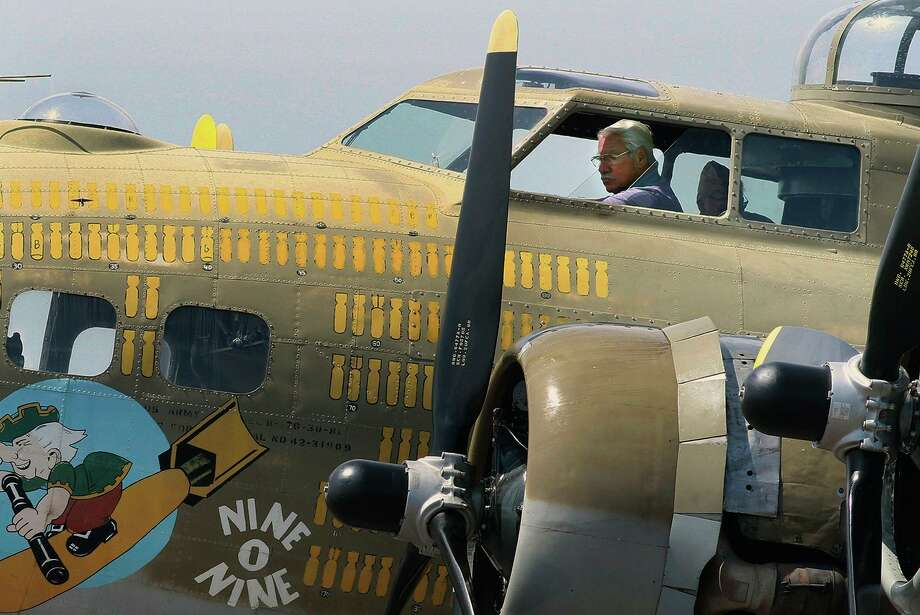 """FILE - In this Aug. 19, 2019 file photo, B-17 pilot, Ernest """"Mac"""" McCauley sits in the cockpit after landing at Hazleton Regional Airport for The Wings of Freedom Tour in Hazle Township, Pa. McCauley, 75, of Long Beach, Calif., and his co-pilot were among seven people killed when the bomber crashed and burned Wednesday, Oct. 2, at Bradley International Airport in Windsor Locks, Conn. (Warren Ruda/Hazleton Standard-Speaker via AP, File)/Hazleton Standard-Speaker via AP) Photo: Warren Ruda / Associated Press / Hazleton Standard-Speaker"""