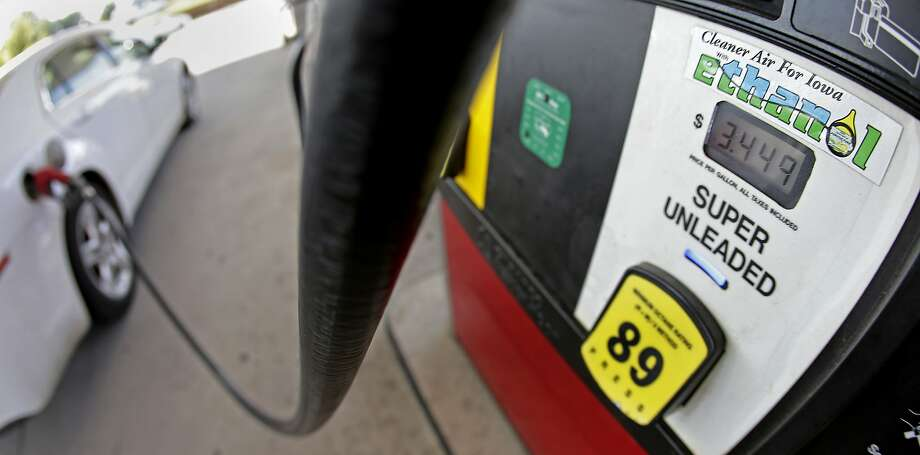 FILE - In this July 26, 2013, file photo, a motorist fills up with gasoline containing ethanol in Des Moines. Photo: Charlie Riedel, Associated Press