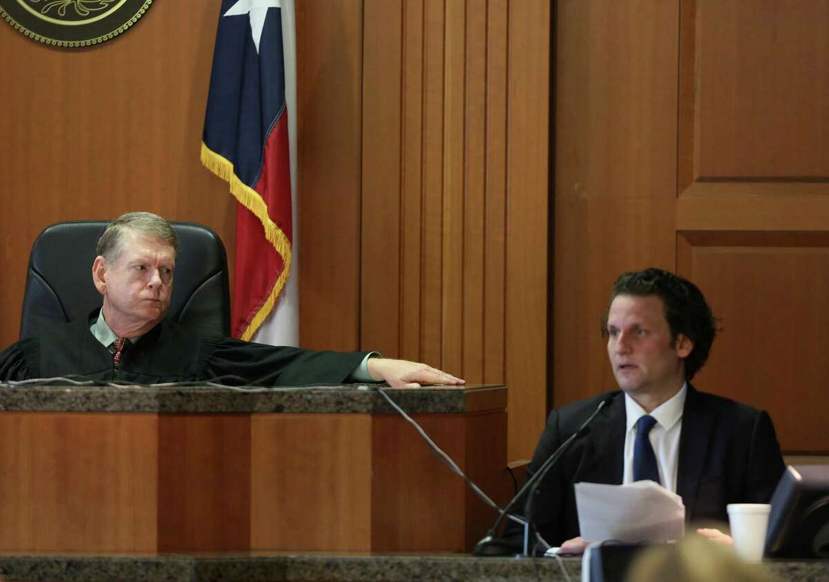 State District Judge Jim Wallace, left, listens to Leon Jacob testify during his murder-for-hire trial in 2018. Wallace left the bench at the end of 2018 and has since taken work as a visiting judge.