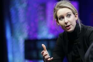 FILE - In this Monday, Nov. 2, 2015 file photo, Elizabeth Holmes, founder and CEO of Theranos, speaks at the Fortune Global Forum in San Francisco. Elizabeth Holmes, who ran Theranos until its 2018 collapse, hasn't paid her Palo Alto, California, attorney John Dwyer and his colleagues for the past year, according to documents filed Monday, Sept. 30, 2019 in Phoenix federal court.  (AP Photo/Jeff Chiu, File)