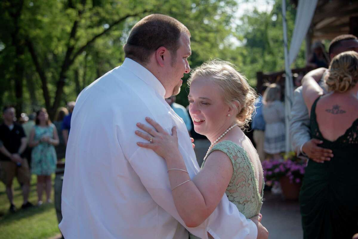 Adam and Abby Jackson were both killed in a limo crash in Schoharie on Oct. 6, 2018. Here they are pictured at Abbya€™s sistera€™s Amya€™s wedding day on June 30, 2018. Amy and her husband Axel were also both killed.