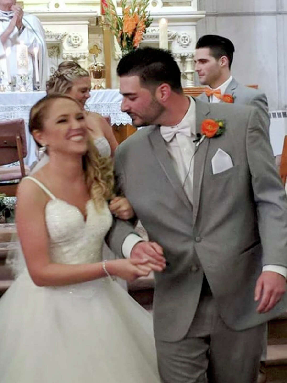 In this June 8, 2018 photograph provided by Valerie Lynne Abeling, Erin and Shane McGowan attend their wedding reception in Amsterdam, N.Y. The couple were among the 20 people who died in Saturday's limousine crash in Schoharie, N.Y.