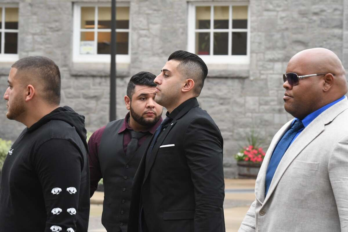 Nauman Hussain, 29, center, the operator of the limousine company involved in the Oct. 6 crash that killed 20 people, arrives in Schoharie County Court Wednesday for a pre-trial conference.