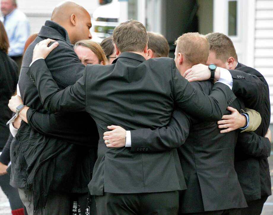 """Mourners embrace following services for Abigail (King) Jackson, Adam """"Action"""" Jackson, Mary (King) Dyson, Robert J. Dyson, Allison A. King, Amy (King) Steenburg, Axel J. Steenburg and Richard Steenburg Jr. at St. Stanislaus Roman Catholic Church Saturday Oct. 13, 2018 in Amsterdam, NY.  (John Carl D'Annibale/Times Union) Photo: John Carl D'Annibale / 20045083A"""