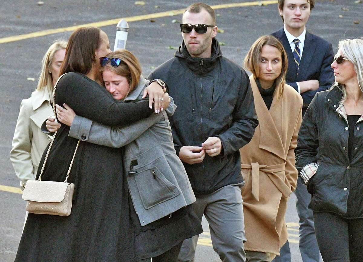 """Mourners leave St. Stanislaus Roman Catholic Church during calling hours for Schoharie limo crash victims; Abigail (King) Jackson, Adam """"Action"""" Jackson, Mary (King) Dyson, Robert J. Dyson, Allison A. King, Amy (King) Steenburg, Axel J. Steenburg and Richard Steenburg Jr., on Friday Oct. 12, 2018, in Amsterdam, N.Y. Funeral service will take place at the church on Saturday. (John Carl D'Annibale/Times Union)"""