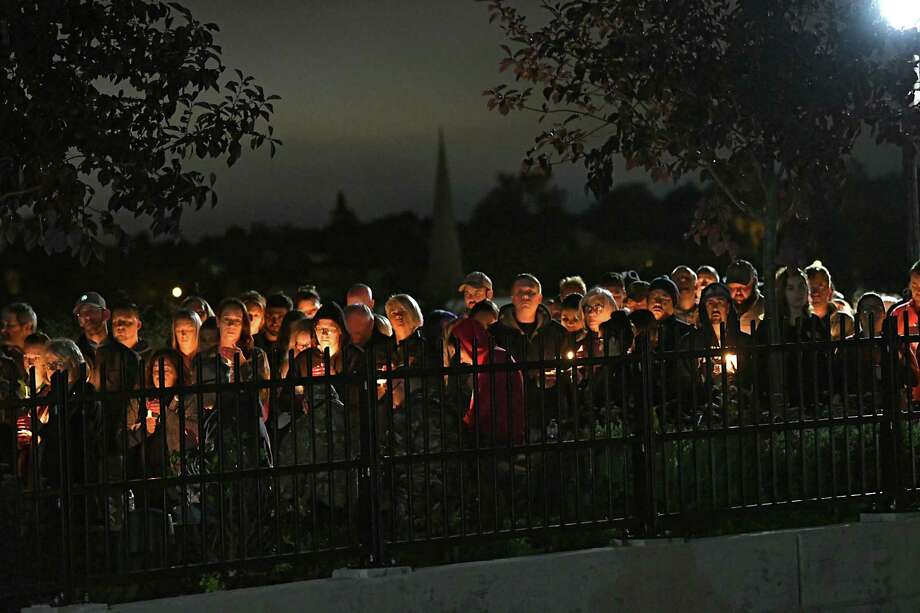 People on a bridge hold candles during a vigil for the victims of the limousine crash in Schoharie at The Mohawk Valley Gateway Overlook Pedestrian Bridge on Monday, Oct. 8, 2018 in Amsterdam, N.Y. (Lori Van Buren/Times Union) Photo: Lori Van Buren / 20045058A