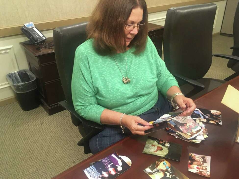 Donna Rivenburg of West Sand Lake looks through photos of her daughter, Amanda, at Rivenburg's lawyer's office in Albany on Oct. 1, 2019. Amanda was 29 when she was one of the victims of the Oct. 6, 2018, limousine crash in Schoharie that killed 20 people. (PhotoA by Steve Barnes/Times Union.)