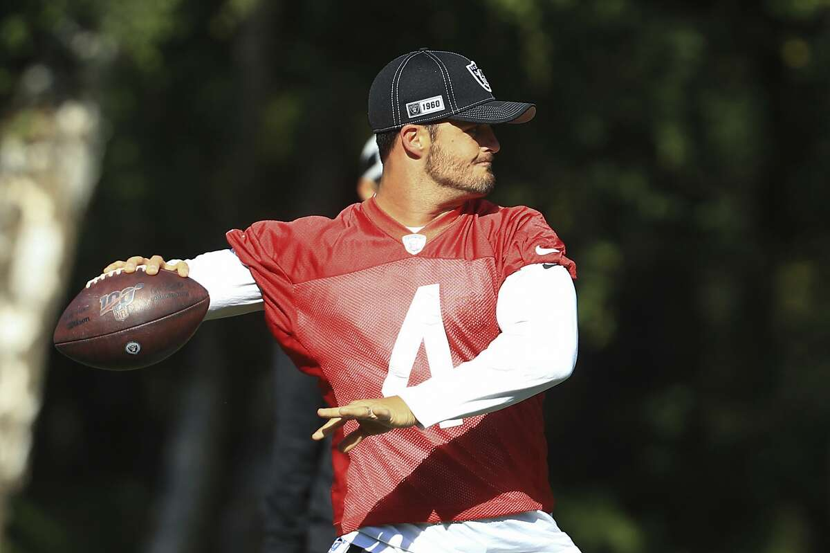 Oakland Raiders' quarterback Derek Carr takes part in an NFL training session in Watford, England, Wednesday, Oct. 2, 2019. The Oakland Raiders are preparing for an NFL regular season game against the Chicago Bears in London on Sunday. (AP Photo/Leila Coker)