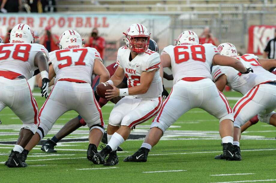 Bronson McClelland (12) of Katy takes a snap during the second quarter of a 6A Region III District 19 football game between the Katy Tigers and the Tompkins Falcons on Thursday, October 3, 2019 at Legacy Stadium, Katy, TX. Photo: Craig Moseley, Houston Chronicle / Staff Photographer / ©2019 Houston Chronicle