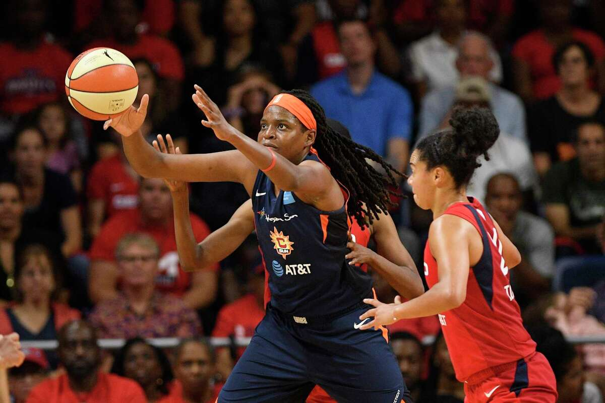Connecticut Sun forward Jonquel Jones, left, reaches for the ball against Washington Mystics guard Kristi Toliver, right, in the second half of Game 2 of the WNBA Finals on Oct. 1 in Washington. Jones will skip the upcoming WNBA season due to coronavirus concerns.