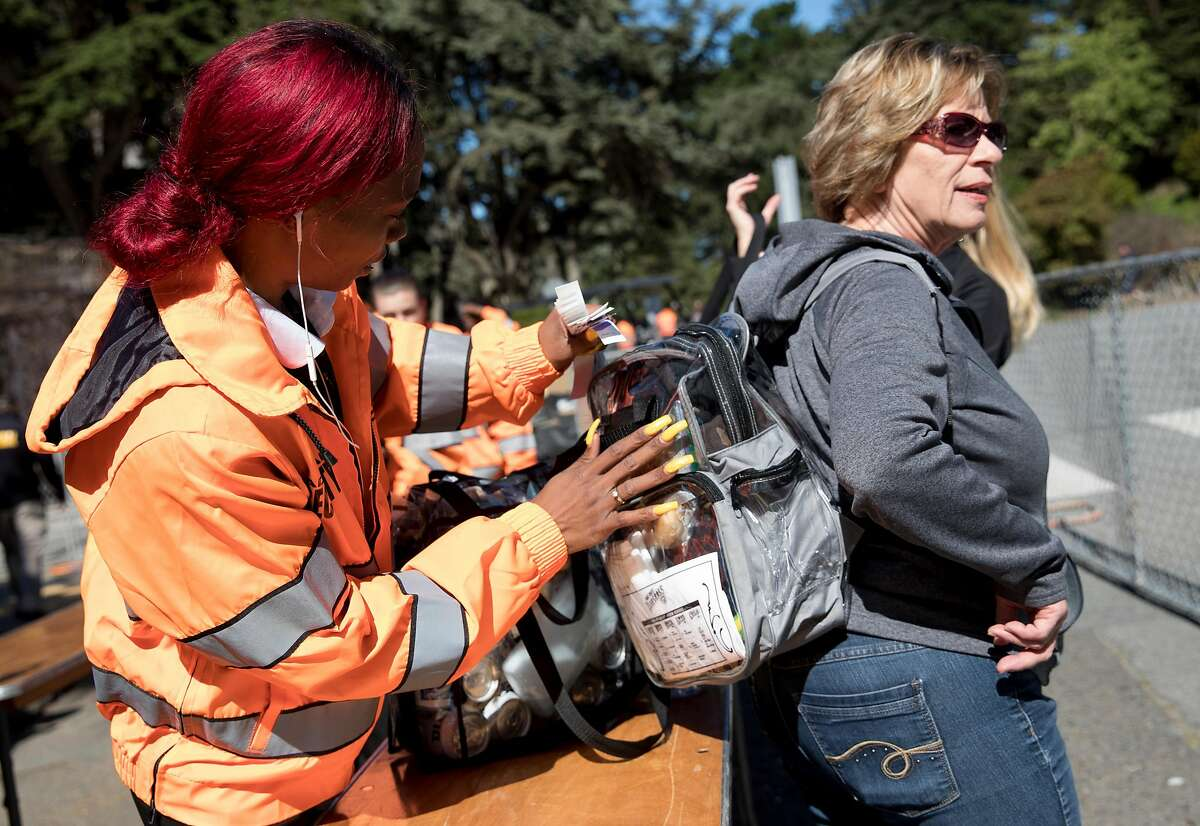 Festival attendees have their bags checked by security during the Hardly Strictly Bluegrass Festival held at Golden Gate Park in San Francisco, Calif. Friday, Oct. 4, 2019.