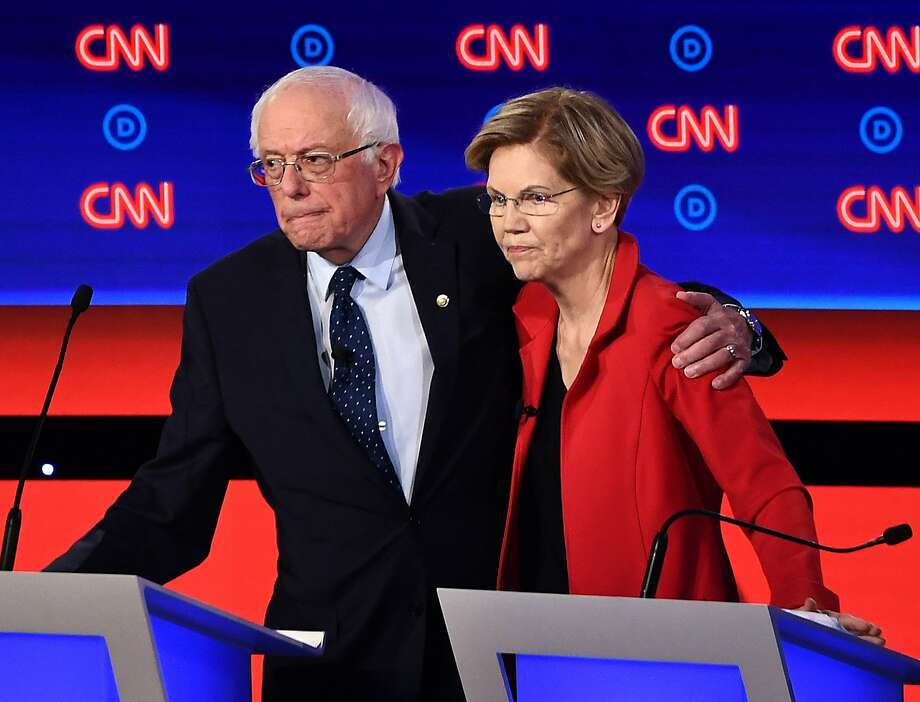In this file photo taken on July 30, 2019, Democratic presidential hopefuls Sen. Bernie Sanders (I-Vt.), left, and Sen. Elizabeth Warren (D-Mass.) after participating in the first round of the second Democratic primary debate of the 2020 presidential campaign season in Detroit. (Brendan Smialowski/AFP/Getty Images/TNS) Photo: Brendan Smialowski/AFP, TNS