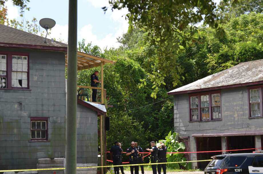 Beaumont Police investigate the southend duplex where four men were shot on Sunday. Police arrested Lively James Stratton of Beaumont in connection with the deaths later that day. Photo: Photo Provided By Eric Williams