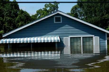 A flooded house in the north end of Beaumont on Thursday. Photo taken Thursday 8/31/17 Ryan Pelham/The Enterprise