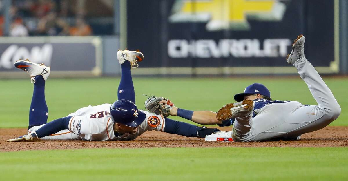 Houston Astros center fielder George Springer (4) steals second base during the third inning of Game 1 of the American League Division Series at Minute Maid Park on Friday, Oct. 4, 2019, in Houston.