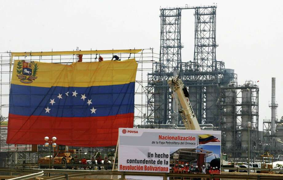 The Trump administration has have given five energy companies with strong ties to Houston permission to stay another three months in Venezuela despite harsh economic sanctions designed to unseat strongman Nicolas Maduro. Photo: JORGE SILVA / REUTERS / X90026
