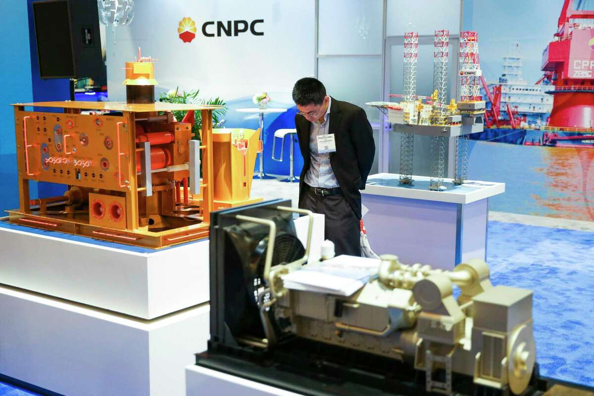 A man looks at a model of a CNPC Horizontal Subsea Christmas Tree during the Offshore Technology Conference.