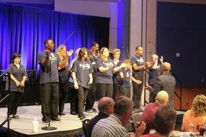 """The Reach Unlimited choir performed """"We Will Rock You"""" by Queen and """"Can't Stop The Feeling!"""" by Justin Timberlake during the luncheon"""