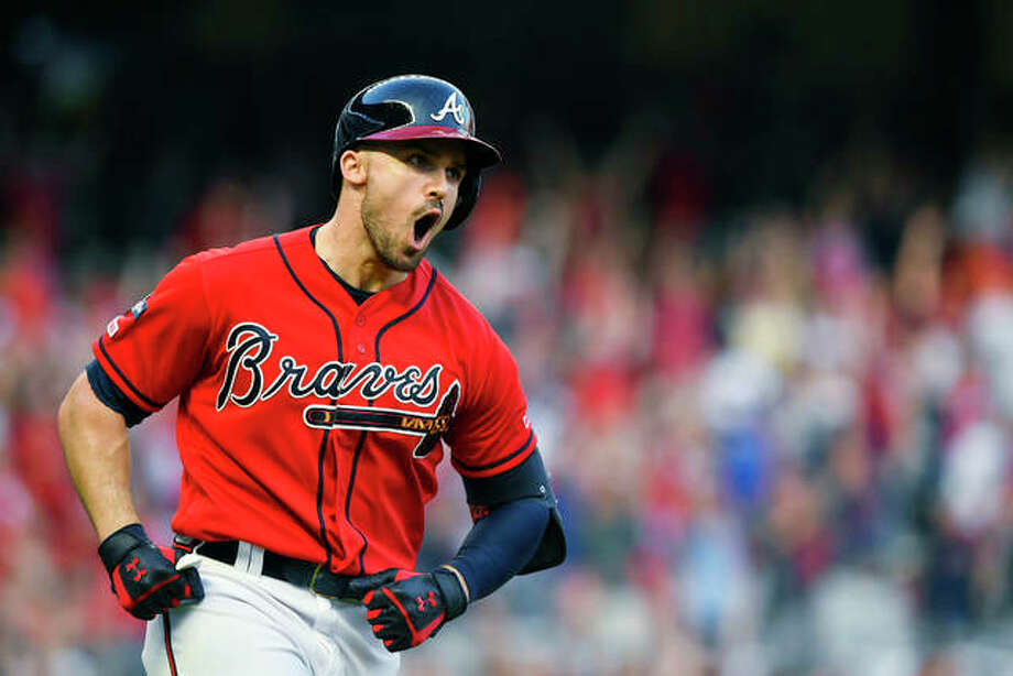 Atlanta Braves Adam Duvall (23) celebrates after hitting a two-run homer against the Cardinals in the seventh inning of Friday in Atlanta. Photo: AP Photo