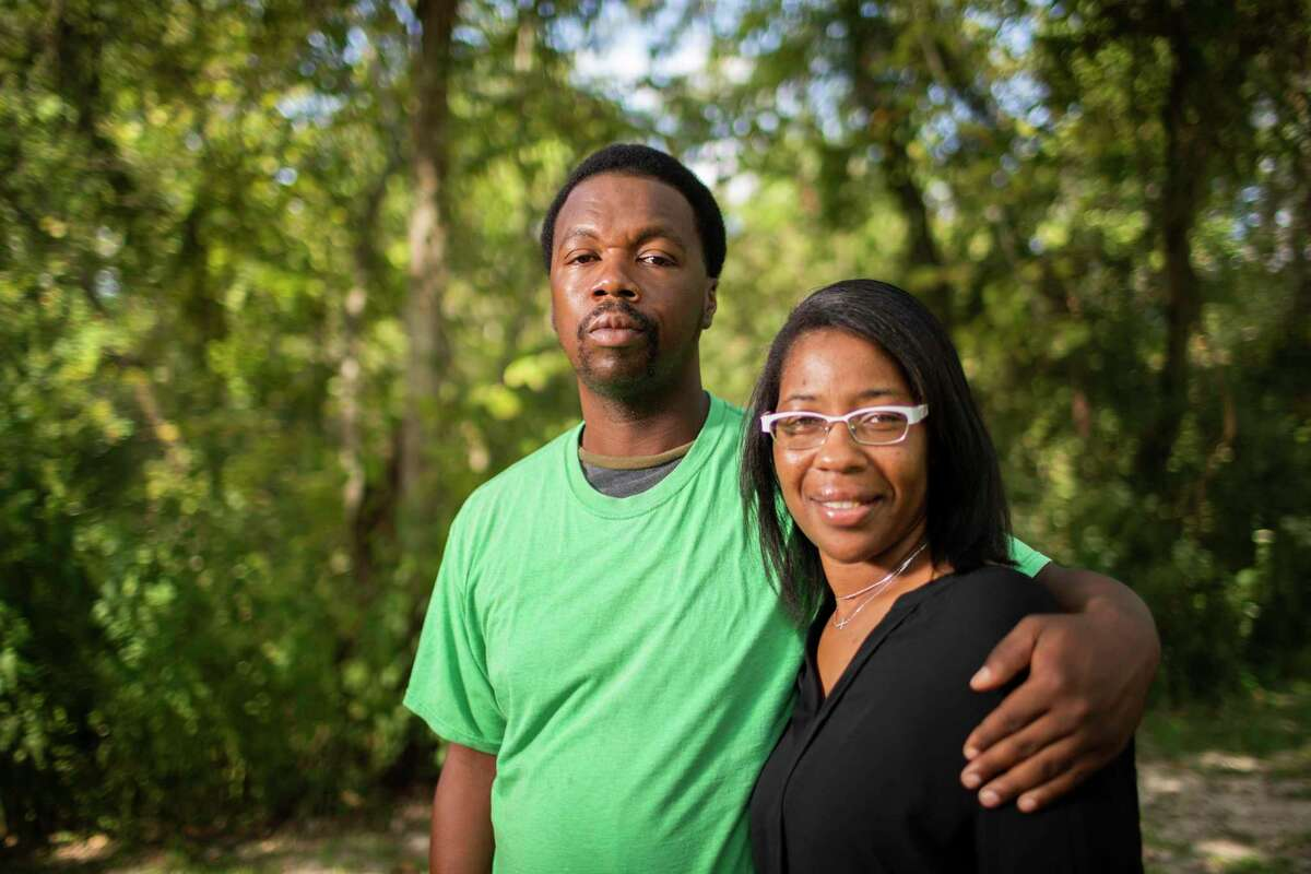 Donald Neely, 43, and his sister Taranette Neely, 42, stand together. Donald Neely was formerly homeless and arrested in Galveston in August for trespassing and clipped to a rope line held by two mounted police officers. A