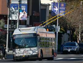 A new model Muni trolley bus picks up passengers at California and Spruce streets in San Francisco, Calif. on Friday, Oct. 4, 2019. The transit agency has completed its program to replace older trolley buses, first entering service in 2001, with a newer fleet of fully electric models that can operate for longer periods independent of the overhead wires.