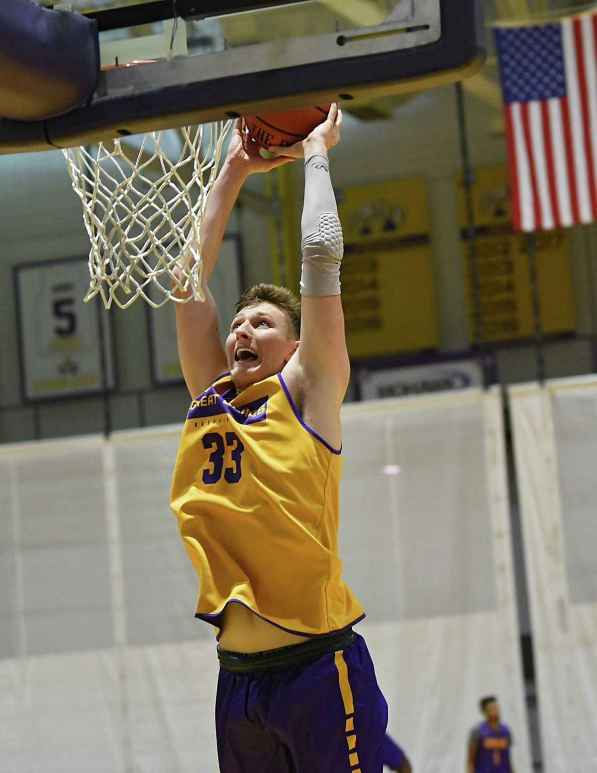 Sasha French slam dunks the ball during the first official practice for the University at Albany basketball team on Friday, Oct. 4, 2019 in Albany, N.Y. (Lori Van Buren/Times Union)