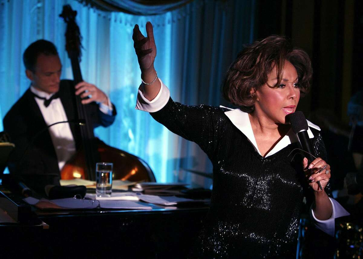 """FILE -- Diahann Carroll performs at Feinstein's cabaret in New York on April 19, 2006. Carroll, who more than half a century ago transcended racial barriers as the star of """"Julia,"""" the first American television series to chronicle the life of a black professional woman, died on Friday, Oct. 4, 2019, at her home in West Hollywood, Calif. She was 84. (Richard Termine/The New York Times)"""
