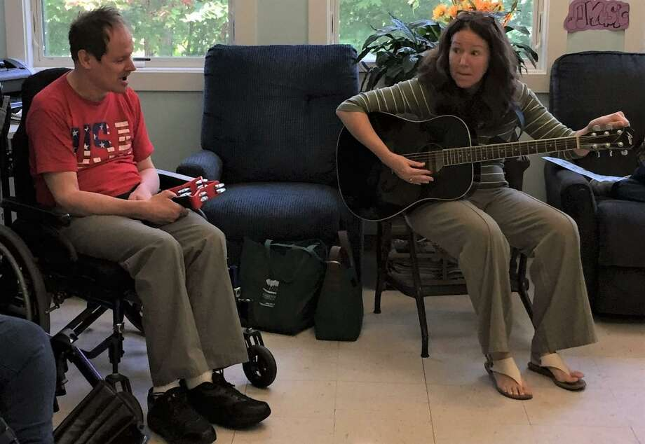 Twice a week, LARC's Day Services Program participants at both the Main Street and Migeon Street LARC locations, engage in a lively hour of music. Music therapist Meg Capen, right, is joined by Larry Dickinson during a recently music therapy class. Photo: LARC / Contributed Photo /