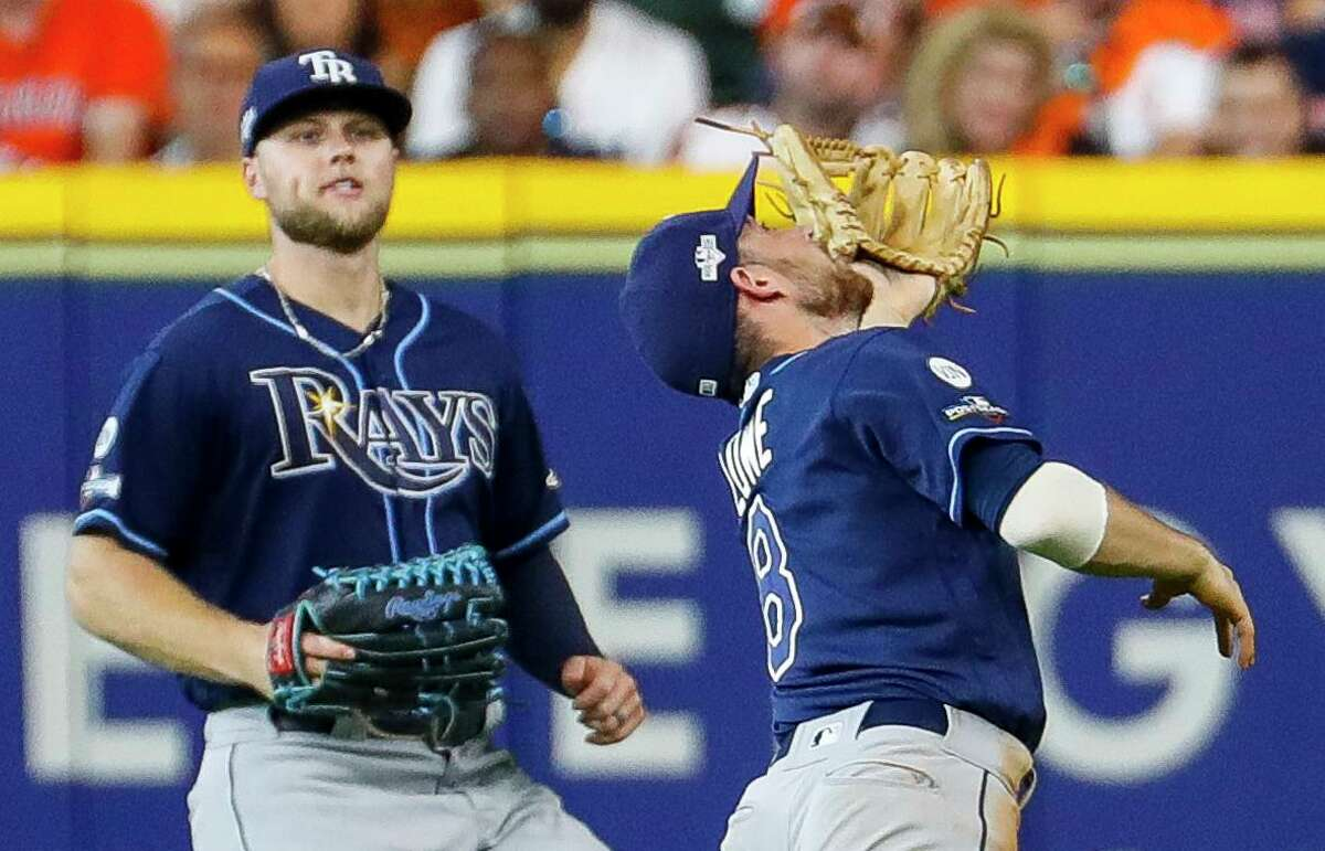 With Rays right fielder Austin Meadows putting on the brakes, second baseman Brandon Lowe tracks a popup that would bounce off his glove, giving the Astros two runs and a 4-0 fifth-inning lead.