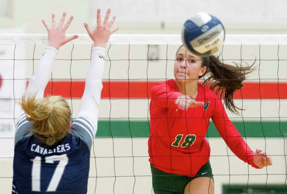 FILE PHOTO — The Woodlands outside hitter Julieta Valdes (18) gets a shot past College Park setter Annie Cooke (17) during the first set of a District 15-6A high school volleyball match at The Woodlands High School, Tuesday, Sept. 3, 2019, in The Woodlands. Photo: Jason Fochtman, Houston Chronicle / Staff Photographer / Houston Chronicle