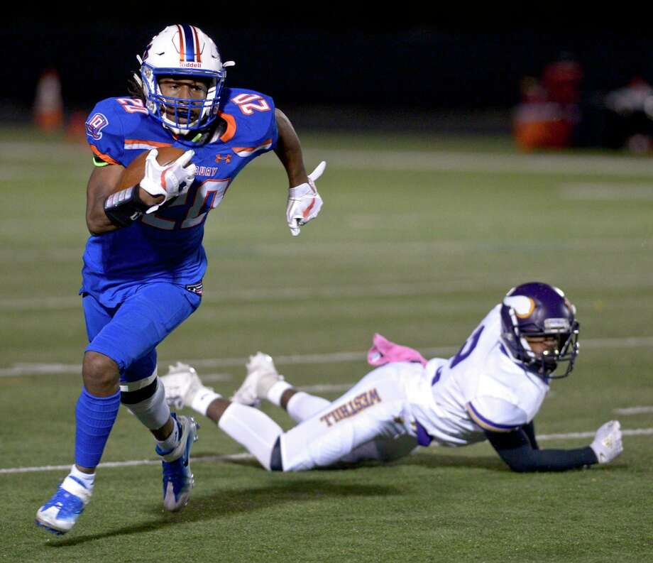 Danbury's Artez Taft gets away from Westhill's Sam Edouard during Friday's game. Photo: H John Voorhees III / Hearst Connecticut Media / The News-Times
