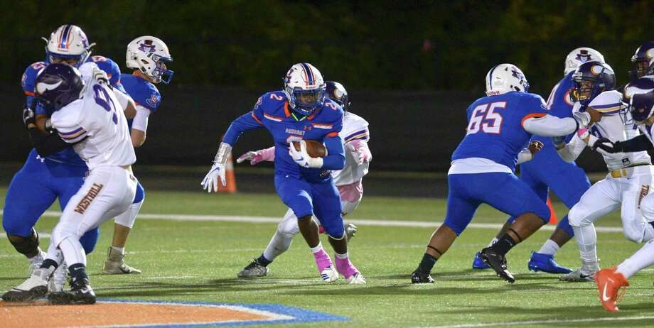 """The state Department of Public Health recommended the CIAC postpone all interscholastic activities — including conditioning and practices for fall sports, like this 2019 game between Danbury HIgh School and Westhill — """"until at least two weeks after the reopening of in-person instruction in schools."""" Photo: H John Voorhees III / Hearst Connecticut Media File Photo / The News-Times"""