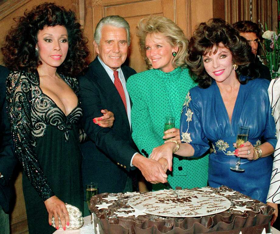 "FILE - This Sept. 24, 1986 file photo shows, Diahann Carroll, John Forsythe, Linda Evans and Joan Collins from ""Dynasty"" cutting a cake to commemorate the production of 150 episodes of the show in Los Angeles. Carroll died, Friday, Oct. 4, 2019, at her home in Los Angeles after a long bout with cancer. She was 84. (AP Photo/Reed Saxon, File) Photo: Reed Saxon / AP2006"