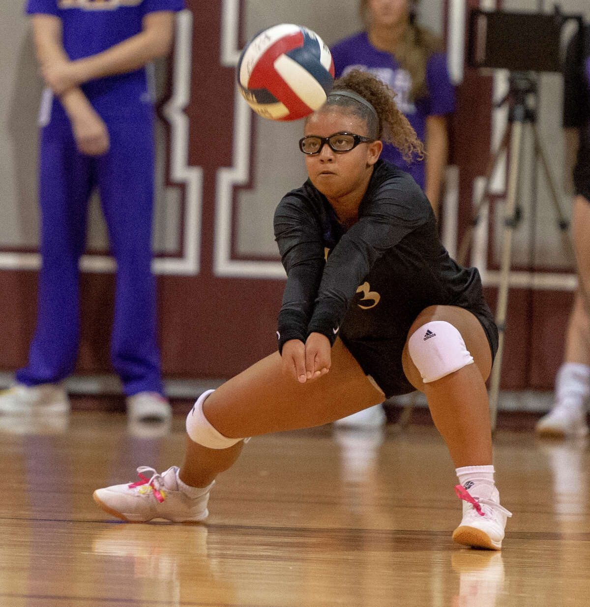 Midland High's Demmi Anders digs the ball Friday, Oct. 4, 2019 at Lee High School gym.