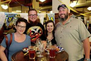 Attendants take part in the Classic Oktoberfest Party at St. Arnold's Brewing Co. in their German-style Beer Hall Friday, Oct. 4, 2019 in Houston, TX.