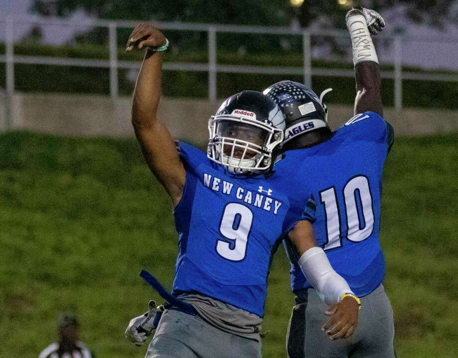 New Caney quarterback Zion Childress (9) and wide receiver Derrick Harris Jr. (10) celebrate after Childress scored during a District 9-5A (Div. I) footbal game Friday, October 4, 2019 at Randall Reed Stadium in New Caney. Photo: Cody Bahn, Houston Chronicle / Staff Photographer / © 2019 Houston Chronicle