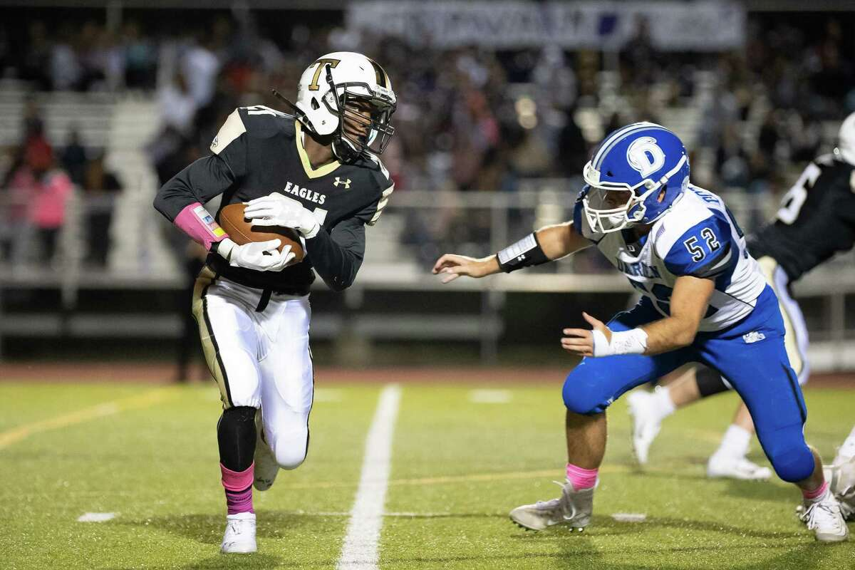 Trumbull's Mileeq Green looks for running room during the Eagles' 41-13 loss to Darien on Friday in Trumbull.