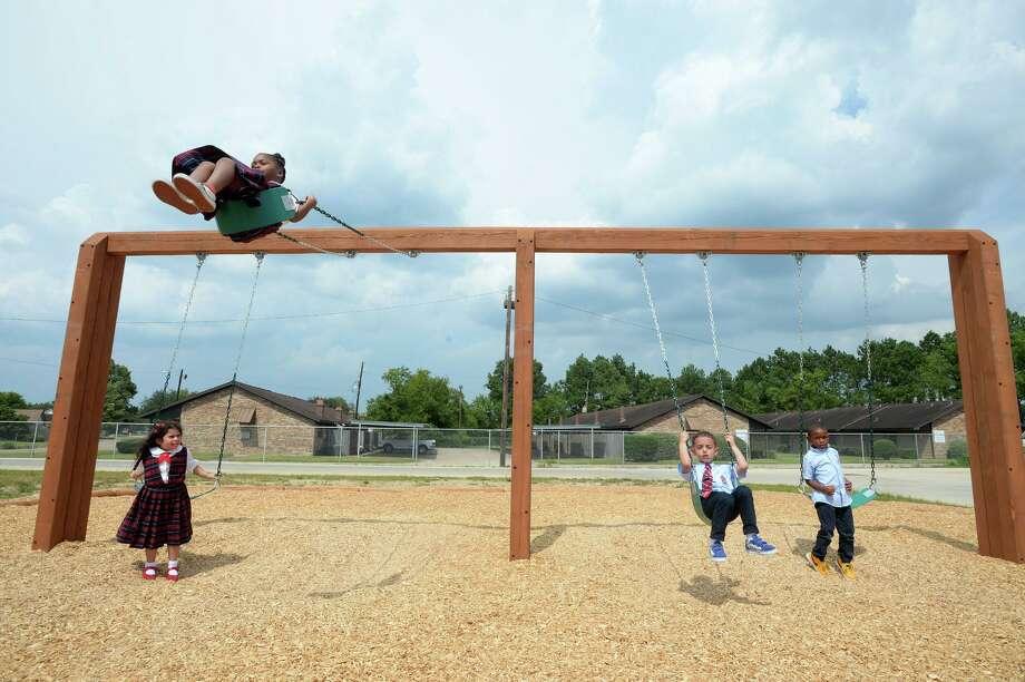 Children swing on the playground at Bob Hope Elementary-Beaumont Campus on Monday.  Photo taken Monday, 9/9/19 Photo: Guiseppe Barranco/The Enterprise, Photo Editor / Guiseppe Barranco ©
