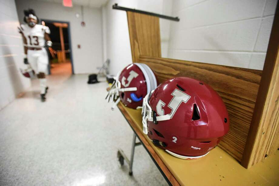 A Jasper football player walks into the locker room at West Orange Stark after the game was cancelled due to lightning strikes. Photo taken on Friday, 10/04/19. Ryan Welch/The Enterprise Photo: Ryan Welch, Beaumont Enterprise / The Enterprise / © 2019 Beaumont Enterprise