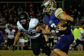 Eagles quarterback Noah Turbyfill (3) scrambles from Bulldogs defensive end Logan Vidmar (84).