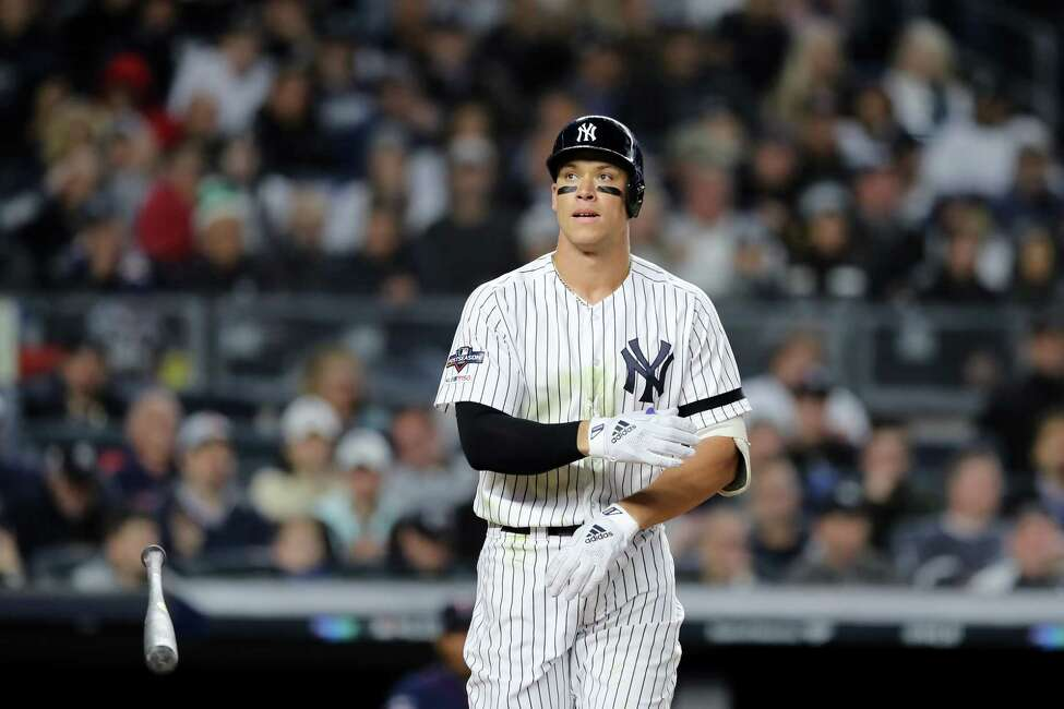 NEW YORK, NEW YORK - OCTOBER 04: Aaron Judge #99 of the New York Yankees reacts after being walked against the Minnesota Twins during the fifth inning in game one of the American League Division Series at Yankee Stadium on October 04, 2019 in New York City. (Photo by Elsa/Getty Images)