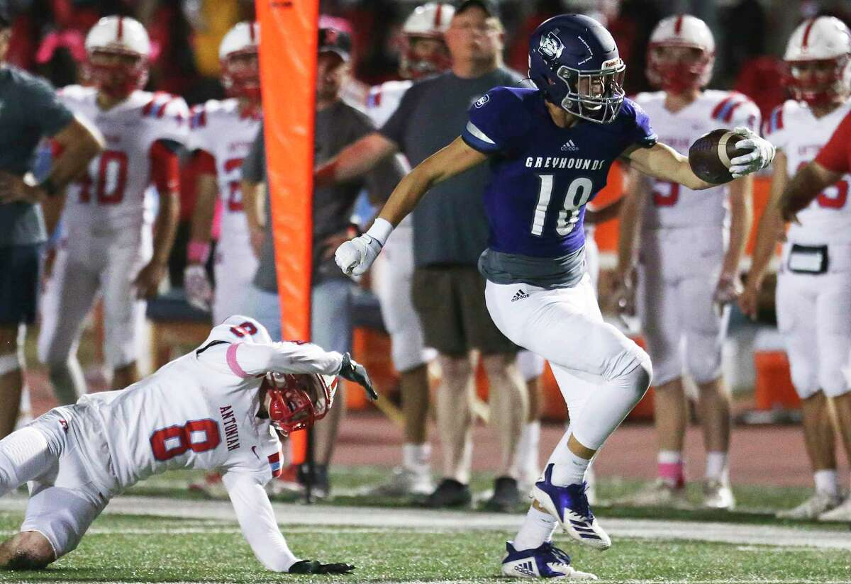 Greyhound receiver Koby Hunter gets the ball upfield after a catch behind Curran Strode as Boerne hosts Antonian at Greyhound Stadium on Oct. 4, 2019.