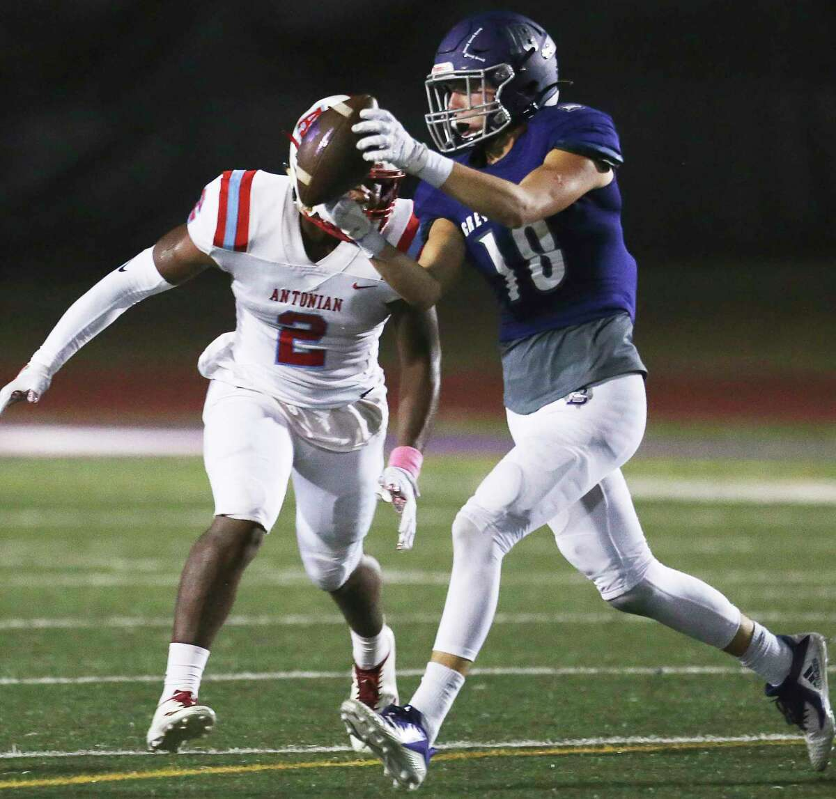 Greyhound receiver Koby Hunter snares a pass in front of Bryon Armstrong as Boerne hosts Antonian at Greyhound Stadium on Oct. 4, 2019.