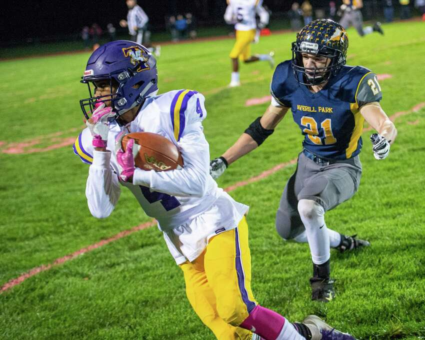 Troy receiver Makai Cruel looks to pick up yardage in front of Averill Park defender Jack Long during a game at Averill Park High School on Friday, Oct. 5, 2019 (Jim Franco/Special to the Times Union.)