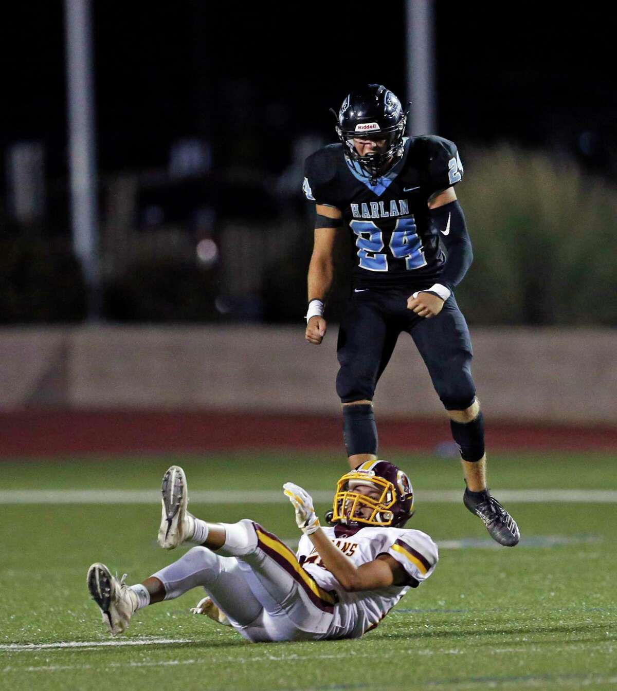 Harlan Zane Svoboda celebrates after knocking down a pass intended to Harlandale Gabriel Mendoza in a District 14-5A-I between Harlandale and Harlan on Friday, October 4, 2019 at Farris Stadium. Harlan won 63-36.